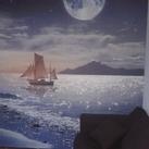 Fotobehang Deel van de babykamer. Rest is lichtblauw en wit.